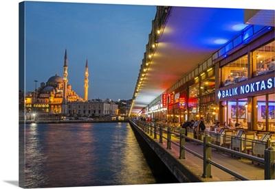 Galata Bridge with Yeni Cami in the background at dusk, Istanbul, Turkey