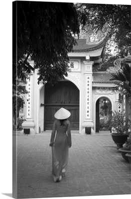 Girl wearing Ao Dai dress, Tran Quoc Pagoda, West Lake (Ho Tay), Hanoi, Vietnam