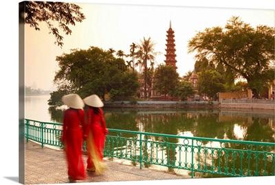 Girls wearing Ao Dai dress, Tran Quoc Pagoda, West Lake (Ho Tay), Hanoi, Vietnam