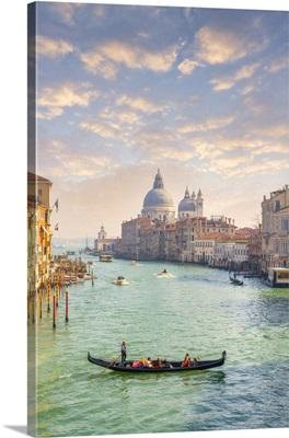 Gondola With Tourists With The Island Of San Giorgio Maggiore, Venice, Italy