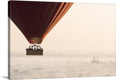 Hot air balloon flying over pagodas in Bagan, Myanmar