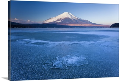 Ice on Lake Yamanaka with snowcovered Mount Fuji in background, Japan