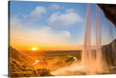 Iceland, Seljalandsfoss at sunset, waterfall and sun