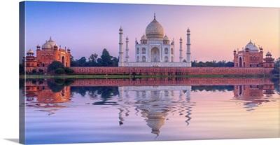 India, The Taj Mahal Mausoleum Reflecting In The Yamuna River At Sunset