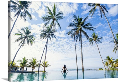 Indonesia, Bali, Candidasa, Woman Looking Out Over The Ocean From An Infinity Pool