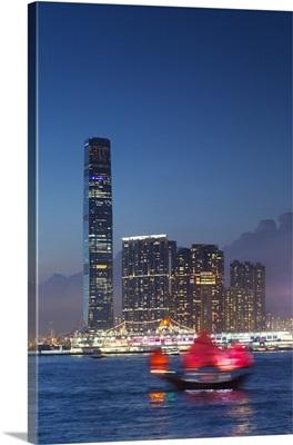 International Commerce Centre and junk boat at dusk, Hong Kong, China