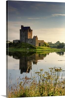 Ireland, Dunguaire castle at sunrise in Kinvara village reflecting in the Atlantic Ocean