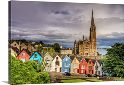 Ireland, Northern Europe; Cobh Cathedral and houses at sunset