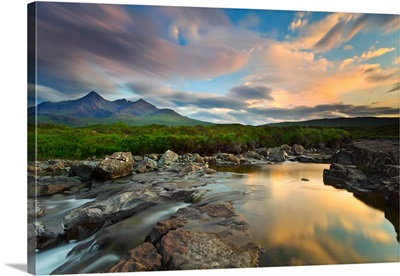 Isle of Skye, Scotland, Europe. The last sunset colors reflected in the water.