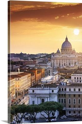 Italy, Rome, St. Peter Basilica and Via della Conciliazione elevated view at sunset