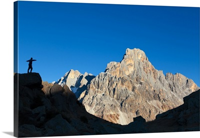 Italy, Silhouette of an hiker looking the Cimon della Pala, Dolomites