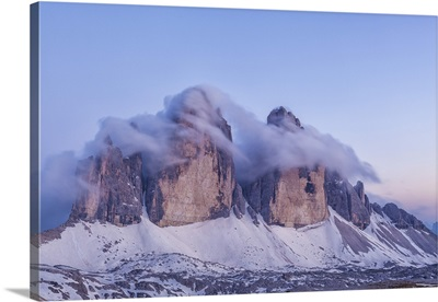 Italy, Trentino-Alto Adige, The Dolomite peaks Tre Cime di Lavaredo wreathed in cloud