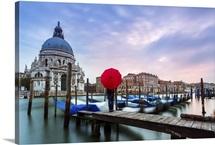 Italy, Veneto, Venice, woman standing with red umbrella