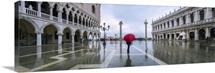 Italy, Veneto, Venice. Woman with red umbrella