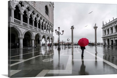 Italy, Veneto, Venice. Woman with red umbrella in front of Doges palace