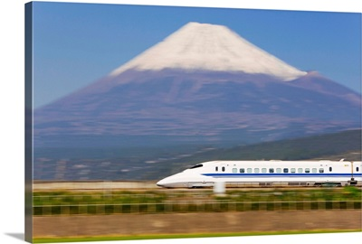 Japan, Honshu, Shinkansen (Bullet train) passing Mount Fuji