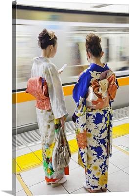 Japan, Tokyo, Girls in Kimono on Subway Platform