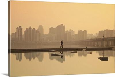 Korea, Seoul, Yeouido, View of city from Hangang Riverside Park at dawn