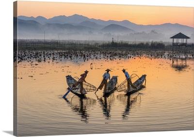 Leg-rowing fishermen of Inle Lake at dawn, Shan State, Myanmar