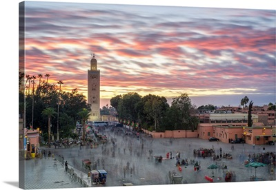 Minaret of Koutoubia Mosque and Jmaa El-Fna square at sunset