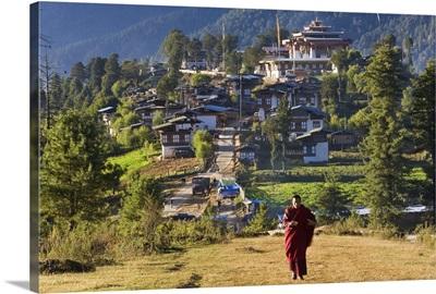 Monk leaving Gangtey Dzong (monastery), and village, Phobjikha Valley, Bhutan