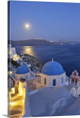Moon over the town of Oia, Santorini, Kyclades, South Aegean, Greece, Europe