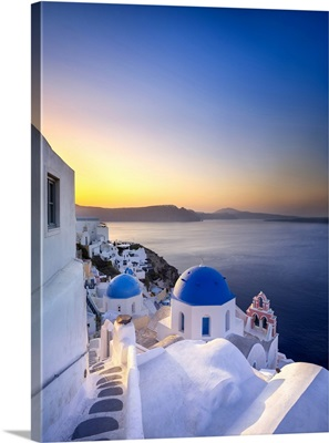 Morning sunlight on the blue houses of Oia, Santorini, Greece