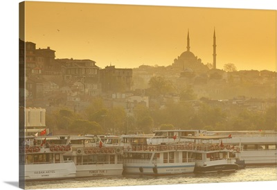 Mosque and ferries on the waterfront of the Golden Horn, Istanbul, Turkey