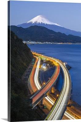Mt. Fuji and traffic driving on the Tomei Expressway, Shizuoka, Honshu, Japan