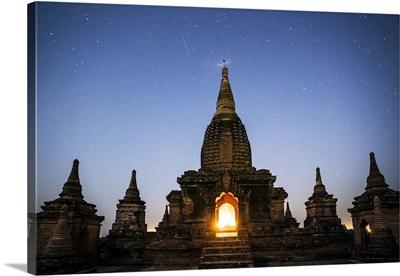 Myanmar, Mandalay division, Bagan. Buddhist pagoda at night under starry sky