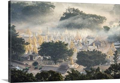 Myanmar, Shan state, Pindaya. Nget Pyaw Taw Pagoda at sunrise, elevated view