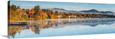 New York, Adirondack Mountains, Lake Placid, Mirror Lake fog at dawn