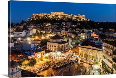 Night city skyline with Monastiraki square and Acropolis in the background, Athens