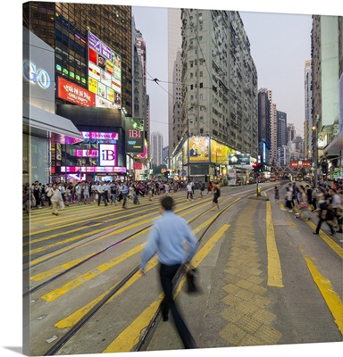 Pedestrians and traffic at a busy road crossing in Causeway Bay, Hong Kong, China