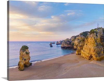 Portugal, Algarve, Lagos, Praia Da Dona Ana, Rock Formations At Dawn