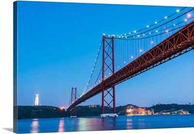 Portugal, Lisbon, The 25 De Abril Bridge Across The Tagus River And Cristo Rei
