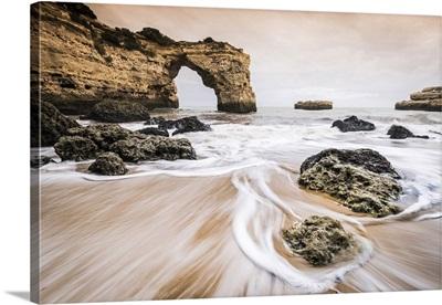 Praia de Albandeira, Lagoa, Algarve, Portugal, Waves between the rocks on the beach