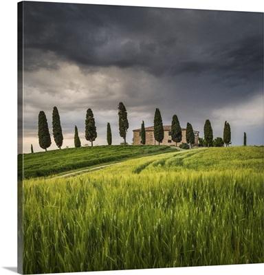 San Quirico d'Orcia, Tuscany, Italy. Farmhouse at sunset