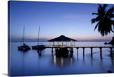 Seychelles, Praslin Island, Anse Bois de Rose, pier at the Coco de Mer hotel, sunset