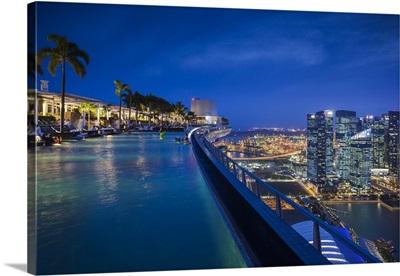 Singapore, Marina Bay Sands Hotel, rooftop swimming pool, dusk
