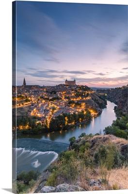 Spain, Castile La Mancha, Toledo. City and river Tagus at sunrise, high angle view