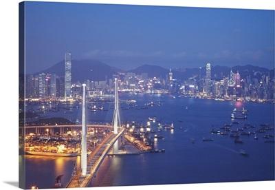Stonecutters Bridge, Victoria Harbour and Hong Kong Island at dusk, Hong Kong, China