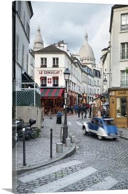 Streets of Montmartre with view towards Basilica Sacre Coeur, Paris, France