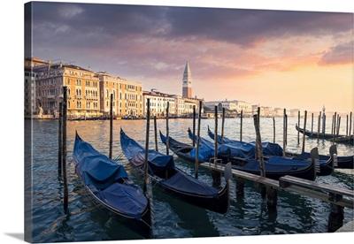 Sunset With Gondolas And St. Mark Belltower. Venice, Veneto, Italy