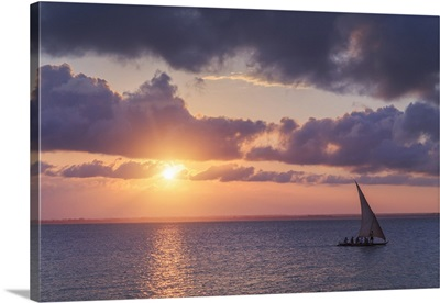 Tanzania. Zanzibar, Michamvi Village, traditional Dhows sailing at sunset