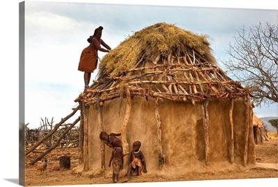 Thatching Himba tribe hut, Kaokoland, Namibia