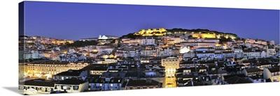 The historical centre and the Sao Jorge castle at dusk, Lisbon, Portugal