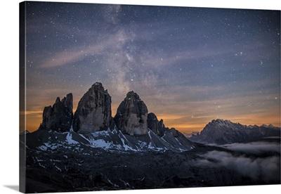 The Milky Way over the three peaks of Lavaredo. Dolomites. Veneto. Italy