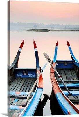 Traditional Burmese boats at sunrise on Taungthaman Lake, Amarapura, Mandalay, Burma
