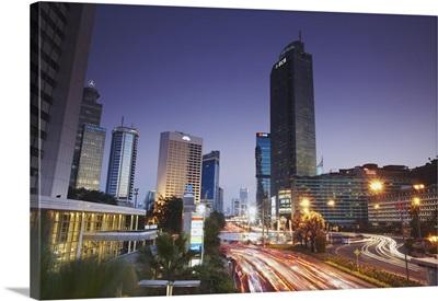 Traffic moving along Jalan Thamsin at dusk, Jakarta, Java, Indonesia